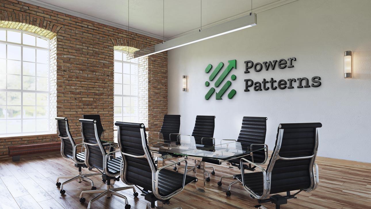 Náhled loga Power Patterns na zdi kanceláře
